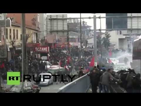 Turkey: Riot police unleash WATER CANNON as Molotov cocktails fly over Gezi victim