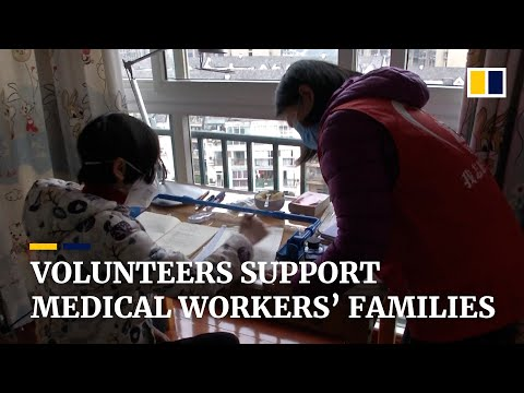 Volunteers take care of families of frontline medical workers fighting the coronavirus in China
