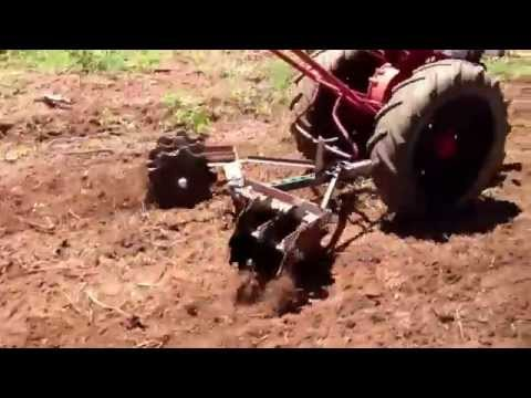 David Bradley walk behind tractor with homemade disc harrow