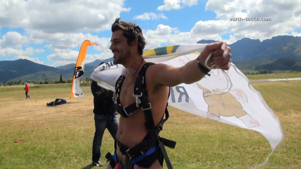 Naked skydiving musician plays violin during jump | by