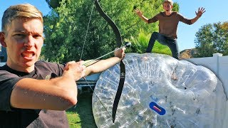 Shoot the Person off the GIANT Inflatable Zorb Ball!!