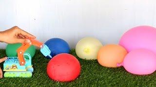 รถแม็คโคร เจาะ ลูกโป่ง ข้างใน มี โปรเกมอน Backhoe puncture balloons inside a Pokemon.