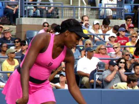 Venus and Serena Williams playing US Open Tennis Doubles