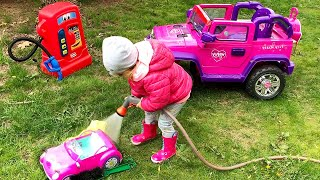 Elis playing Car Wash with Cleaning Toys