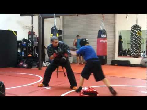 Caleb sparring with Master Tim Kirby