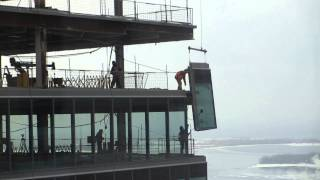 TO High Rise-construction workers installing window on 38th flr Part1