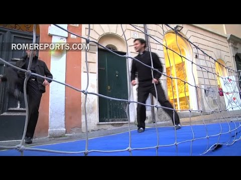 Priests invite tourists to a soccer match in the center of Rome