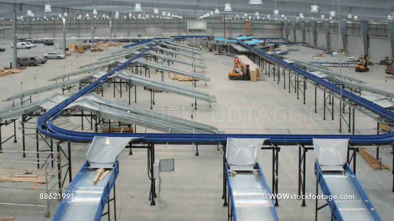 Parcel Conveyer System Being Installed Into Empty