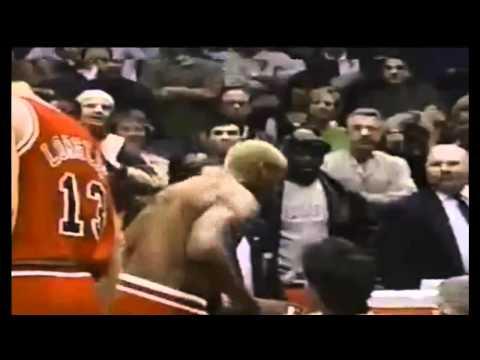 Dennis Rodman headbutts the referee.
