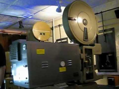 Old 1940s cinema film projectors playing Pathe news reels from WWII / WW2