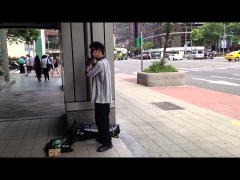 Boy plays Flute in Taipei