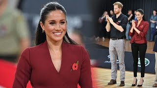 Harry & Meghan lead cheering section at Invictus Games - a cheeky player steals a kiss