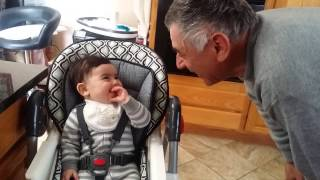 Baby laughing with grandpa