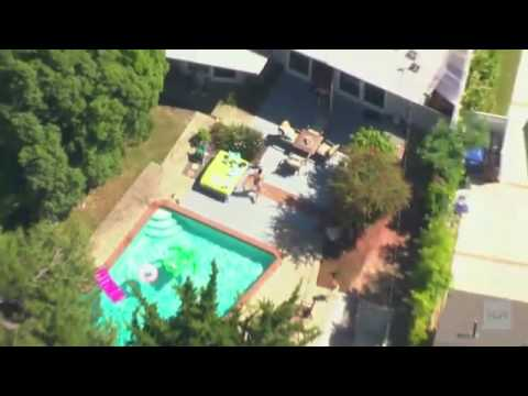 Bear cub crashes backyard pool party
