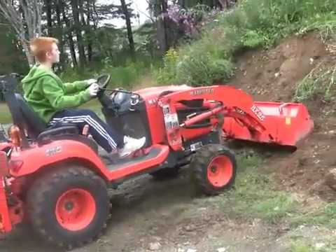 Max learning to use backhoe and FEL Kubota BX25