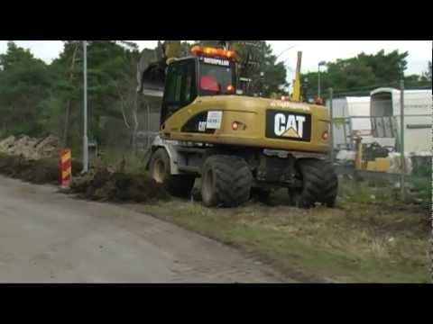 Caterpillar excavator digging a cable trench outside Visby 2012