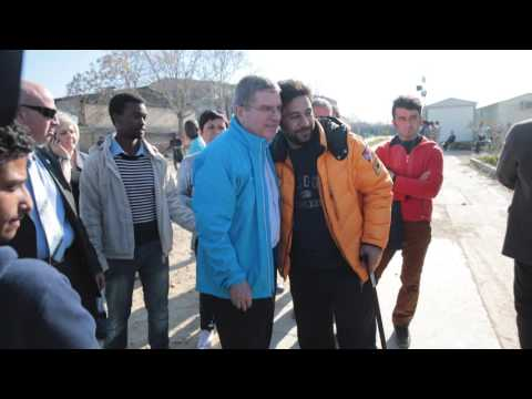 IOC Thomas Bach President visits refugees in Athens