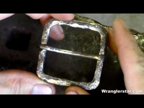 Blacksmith Forging A Belt Buckle