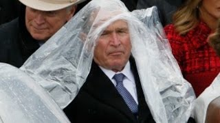 George W. Bush struggles with his poncho at Trump's inauguration