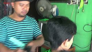 the pregnant woman gets flattop at traditional barbershop