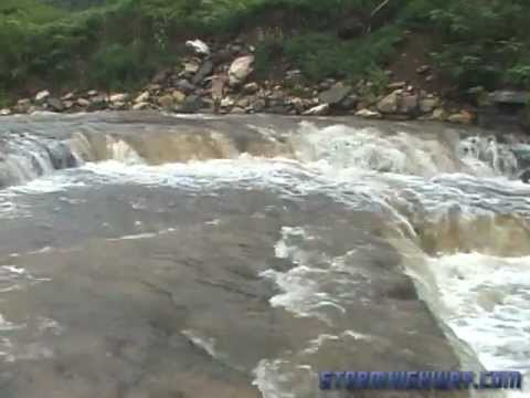 Sudden Flash Flood Wave Fills A Creek Bank To Bank In
