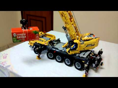 LEGO 42009 Mobile Crane lifting a tea box
