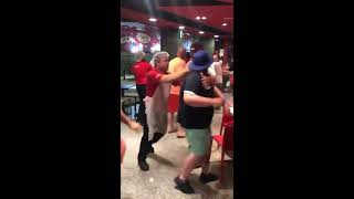 English football fans fighting in KFC in Benidorm