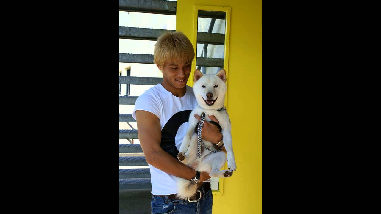 Photo of Keisuke Honda & his  Dog Tetsu
