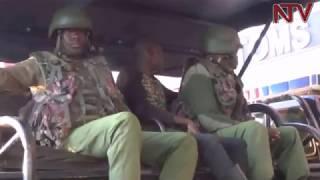 Uganda ekutte abapoliisi ba Kenya basatu
