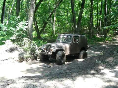 mudding jeep yj
