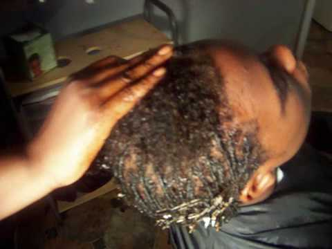 Video on me starting dread locks on my client. www.Thebestsalon.com.