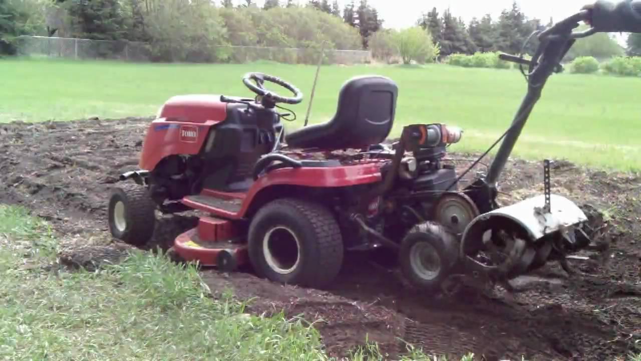 Scabbin A Rototiller On The Garden Tractor Youtube