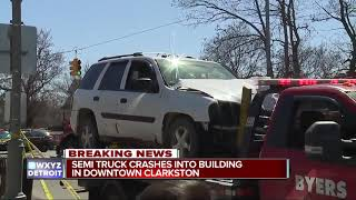 Driver hurt as semi truck crashes into dental office in downtown Clarkston