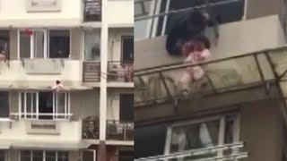 Strangers Risk Their Lives to Rescue Toddler Dangling From Balcony