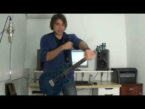 Cómo tocar de Pie la guitarra eléctrica Miguel Rivera