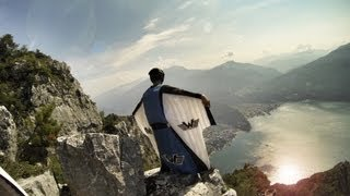 Crazy Wingsuit Flight -- Man Lands on Water Without Parachute?