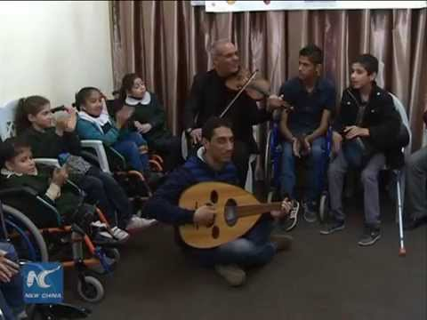 Disabled Gaza kids' music rehabilitation club