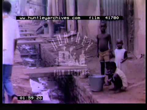 Children washing in buckets.  Poverty in Mali in Africa in the 1970's.  Film 41780