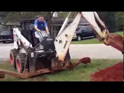 Digging sewage with bobcat 863,  backhoe 811 attachment