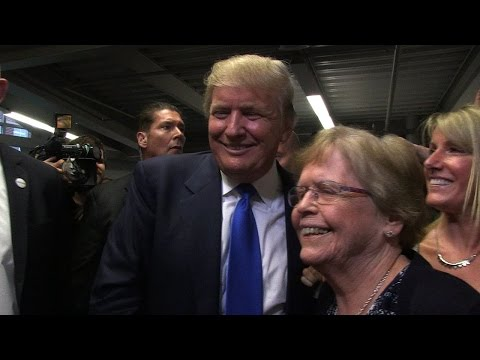 Candidate Donald Trump appears in NH with fanfare