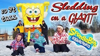 BEST SNOW DAY EVER! Sledding on Inflatable Floaties GIANT Spongebob Square Pants Pool Float Toy