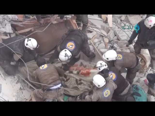 Raw: Girl Rescued from Rubble in Syrian Town