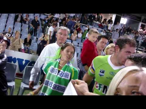 Canberra Raiders vs Cronulla Sharks - Fans jumping on the field post game.