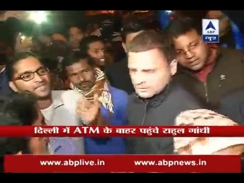 Congress VP Rahul Gandhi meets people outside ATM in Delhi