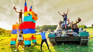 BLOWING UP GIANT PINATA WITH A TANK! (This was insane!)