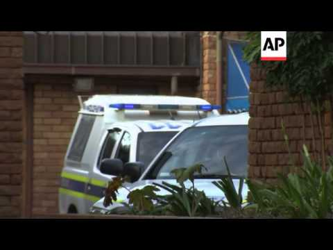 Oscar Pistorius leaves police cell and arrives at court for second day of bail hearing
