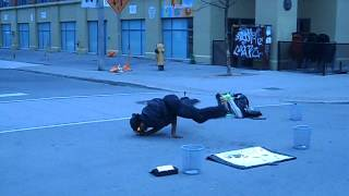 Busker does some breakdancing
