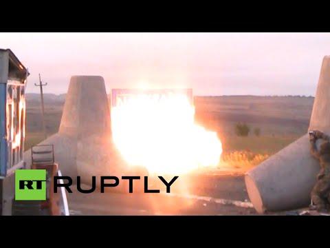 RAW: Fierce tank battle rages near Ukraine-Russia border crossing