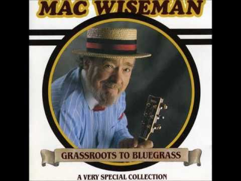 (Beneath That) Lonely Mound Of Clay~Mac Wiseman.wmv