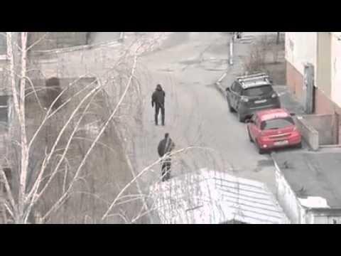 Ограбление автомобииля в Киеве средь бела дня
